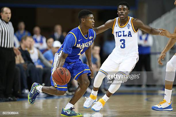 Jamaya Burr of the McNeese State Cowboys looks to make a play as Aaron Holiday of the UCLA Bruins defends in the second period at Pauley Pavilion on...