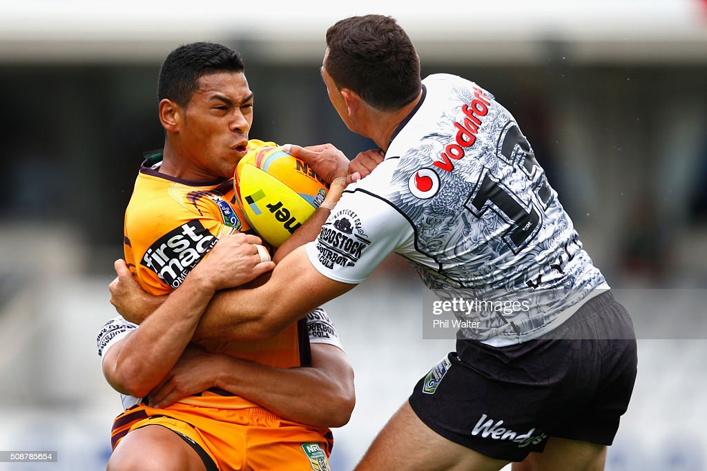 Jamayne Isaako of the Broncos is tackled by Jonathan Wright of the Warriors during the 2016 Auckland Nines match between the New Zealand Warriors and the Brisbane Broncos at Eden Park on February 7, 2016 in Auckland, New Zealand.