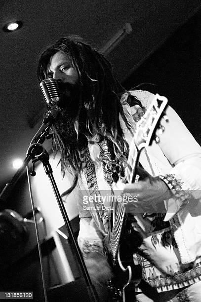 Image has been converted to black and white Jameel Abdul Kebab performs live with Steve MacKay at La Machine du Moulin Rouge on December 17 2010 in...
