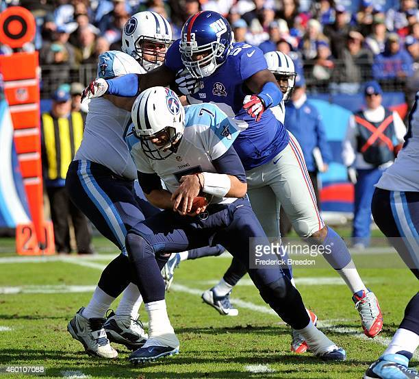 Jameel McClain of the New York Giants sacks quarterback Zach Mettenberger of the Tennessee Titans during the first quarter in a game at LP Field on...