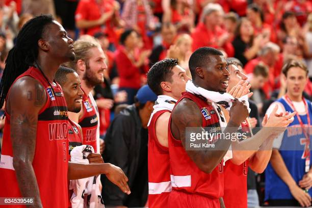 Jameel McKay Bryce Cotton Jesse Wagstaff Jarrod Kenny Casey Prather and Damian Martin of the Wildcats cheer on from the bench in the dying seconds...