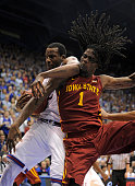 Jameel McKay of the Iowa State Cyclones and Cliff Alexander of the Kansas Jayhawks battle for a rebound in the second half at Allen Field House on...
