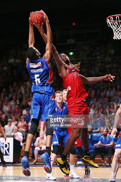 Jameel McKay of the Perth Wildcats blocks a shot by Terrance Ferguson of the Adelaide 36ers during the round nine NBL match between the Adelaide...