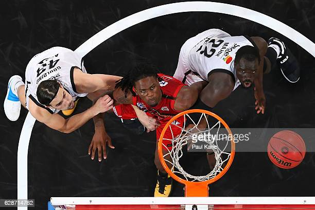 Jameel McKay of the Wildcats contests for a rebound against Chris Goulding and Majok Majok of United during the round 10 NBL match between the Perth...