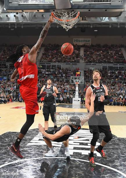 Jameel McKay of the Wildcats dunks the ball over the top of Chris Goulding of United during the round 19 NBL match between Melbourne United and the...