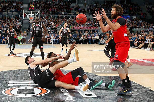 Jameel McKay of the Wildcats passes the ball from the floor to Matt Knight of the Wildcats during the round three NBL match between Melbourne United...