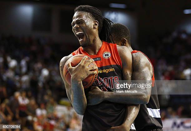 Jameel Mckay of the Willdcats celebrates victory with team mate Casey Prather of the Wildcats during the round 13 NBL match between Illawarra and...