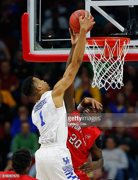 Jameel Warney of the Stony Brook Seawolves blocks a shot by Skal Labissiere of the Kentucky Wildcats in the first half during the first round of the...