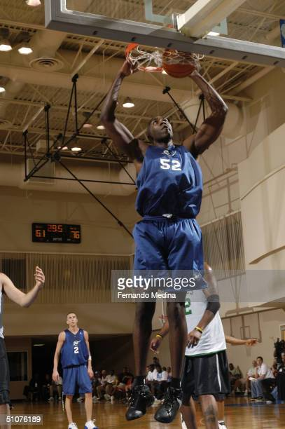 Jameel Watkins of the Washington Wizards dunks against the Boston Celtics during a 2004 NBA Pepsi Pro Summer League game at the RDV Sportsplex on...
