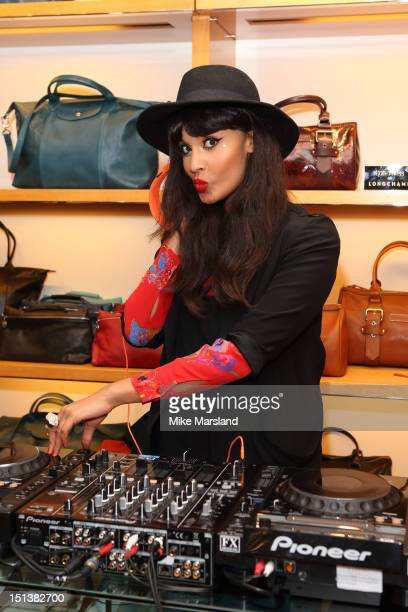 Jameela Jami attends Longchamp's celebrations for Vogue's Fashion Night Out at Longchamp on September 6 2012 in London England