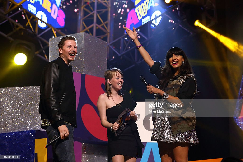 <a gi-track='captionPersonalityLinkClicked' href=/galleries/search?phrase=Jameela+Jamil&family=editorial&specificpeople=5441115 ng-click='$event.stopPropagation()'>Jameela Jamil</a> and <a gi-track='captionPersonalityLinkClicked' href=/galleries/search?phrase=Professor+Green&family=editorial&specificpeople=6919860 ng-click='$event.stopPropagation()'>Professor Green</a> onstage at the Radio One Teen Awards at Wembley Arena on October 7, 2012 in London, England.