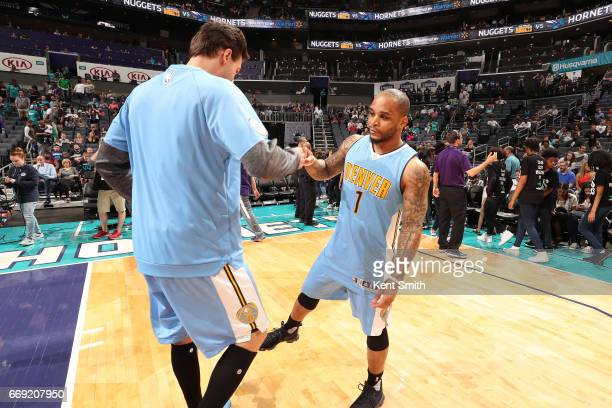 Jameer Nelson and Danilo Gallinari of the Denver Nuggets are seen before the game against the Charlotte Hornets on March 31 2017 at Spectrum Center...