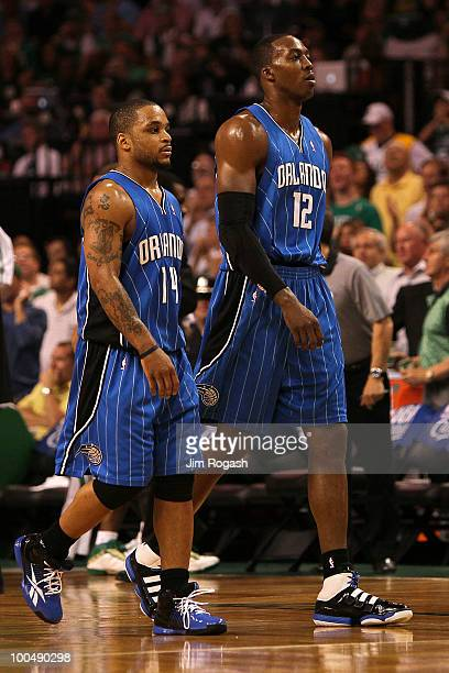 Jameer Nelson and Dwight Howard of the Orlando Magic walk towards the bench against the Boston Celtics in Game Four of the Eastern Conference Finals...