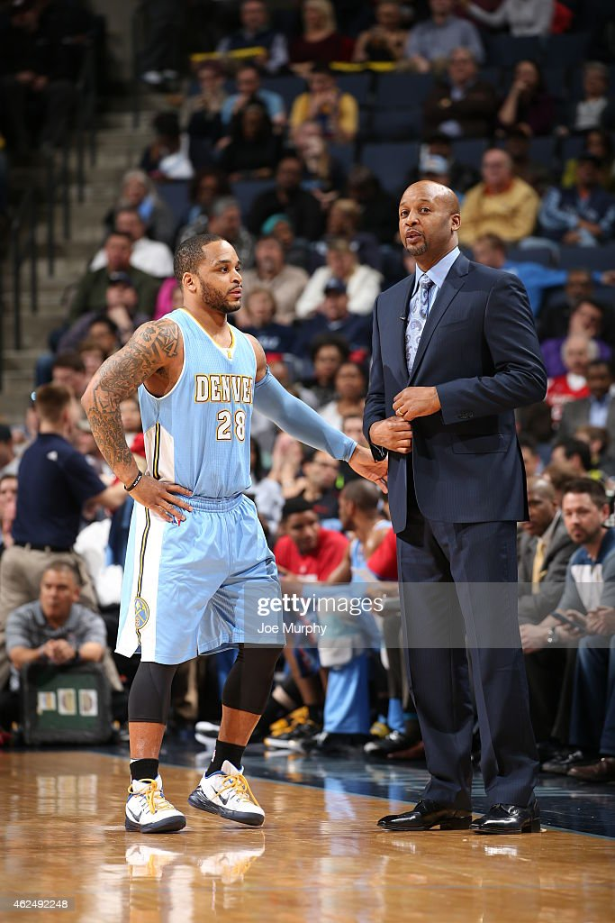 Jameer Nelson and head coach Brian Shaw of the Denver Nuggets talk during the game against the Memphis Grizzlies on January 29 2015 at FedExForum in...