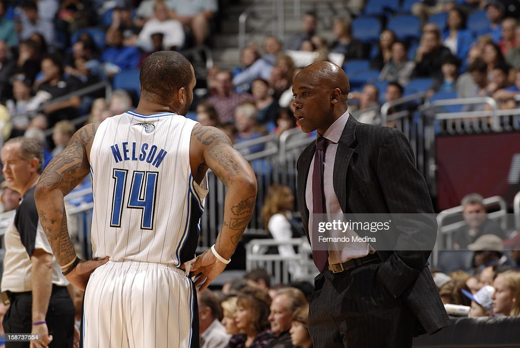 <a gi-track='captionPersonalityLinkClicked' href=/galleries/search?phrase=Jameer+Nelson&family=editorial&specificpeople=202057 ng-click='$event.stopPropagation()'>Jameer Nelson</a> #14 and head coach <a gi-track='captionPersonalityLinkClicked' href=/galleries/search?phrase=Jacque+Vaughn&family=editorial&specificpeople=201747 ng-click='$event.stopPropagation()'>Jacque Vaughn</a> talk during a break in play during the New Orleans Hornets , Orlando Magic game on December 26, 2012 at Amway Center in Orlando, Florida.