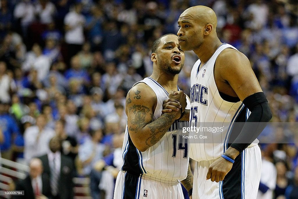 Jameer Nelson #14 and Vince Carter #15 of the Orlando Magic talk on court against the Boston Celtics in Game Two of the Eastern Conference Finals during the 2010 NBA Playoffs at Amway Arena on May 18, 2010 in Orlando, Florida.