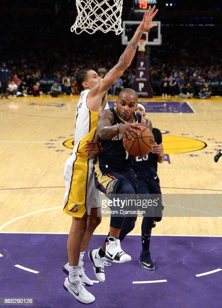 Jameer Nelson New Orleans Pelicans looks to pass under pressure from Kyle Kuzma of the Los Angeles Lakers during the second half at Staples Center...