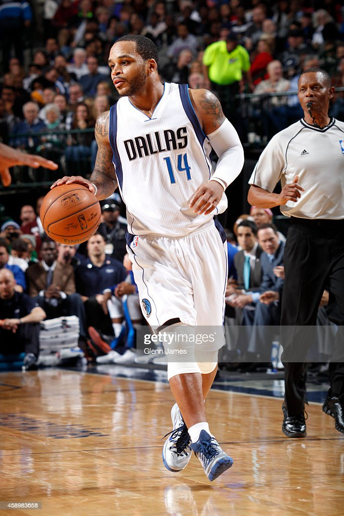 Jameer Nelson #14 of the Dallas Mavericks handles the ball against the Sacramento Kings on November 11, 2014 at the American Airlines Center in Dallas, Texas.