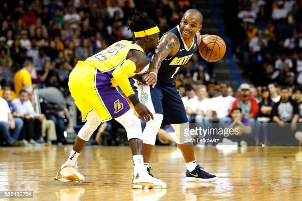 Jameer Nelson of the Denver Nuggets looks to pass while being guarded by Briante Weber of the Los Angeles Lakers during a preseason game at Citizens...