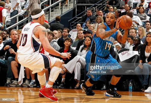 Jameer Nelson of the Orlando Magic against Mike Bibby of the Atlanta Hawks during Game Four of the Eastern Conference Semifinals of the 2010 NBA...