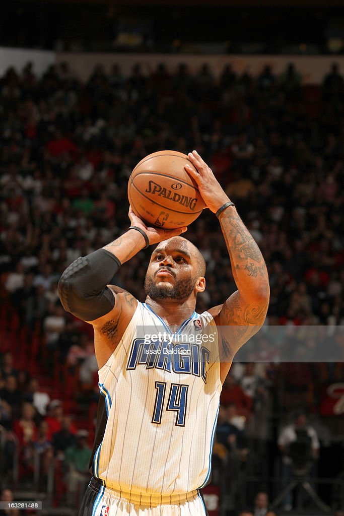 Jameer Nelson #14 of the Orlando Magic aims for a free throw during the game between the Orlando Magic and the Miami Heat on March 6, 2013 at American Airlines Arena in Miami, Florida.