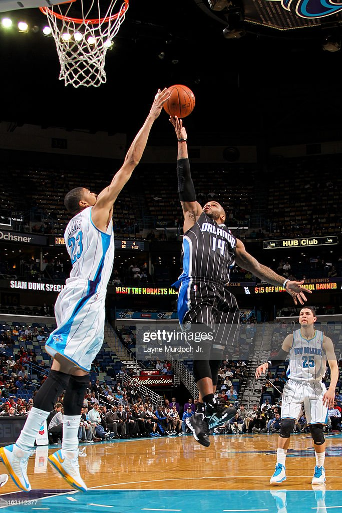<a gi-track='captionPersonalityLinkClicked' href=/galleries/search?phrase=Jameer+Nelson&family=editorial&specificpeople=202057 ng-click='$event.stopPropagation()'>Jameer Nelson</a> #14 of the Orlando Magic attempts a layup against <a gi-track='captionPersonalityLinkClicked' href=/galleries/search?phrase=Anthony+Davis+-+Basketball+Player&family=editorial&specificpeople=9539354 ng-click='$event.stopPropagation()'>Anthony Davis</a> #23 of the New Orleans Hornets on March 4, 2013 at the New Orleans Arena in New Orleans, Louisiana.