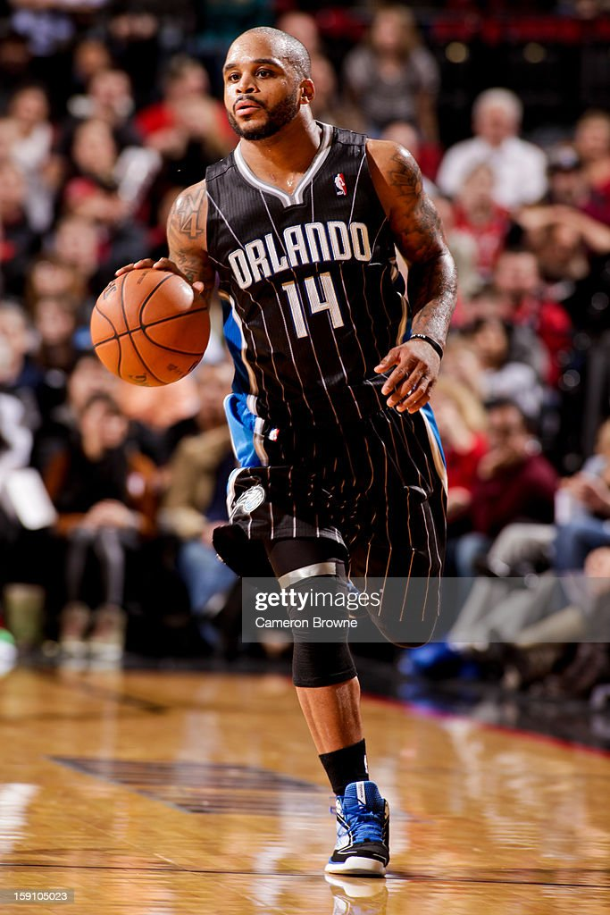 <a gi-track='captionPersonalityLinkClicked' href=/galleries/search?phrase=Jameer+Nelson&family=editorial&specificpeople=202057 ng-click='$event.stopPropagation()'>Jameer Nelson</a> #14 of the Orlando Magic brings the ball up court against the Portland Trail Blazers on January 7, 2013 at the Rose Garden Arena in Portland, Oregon.