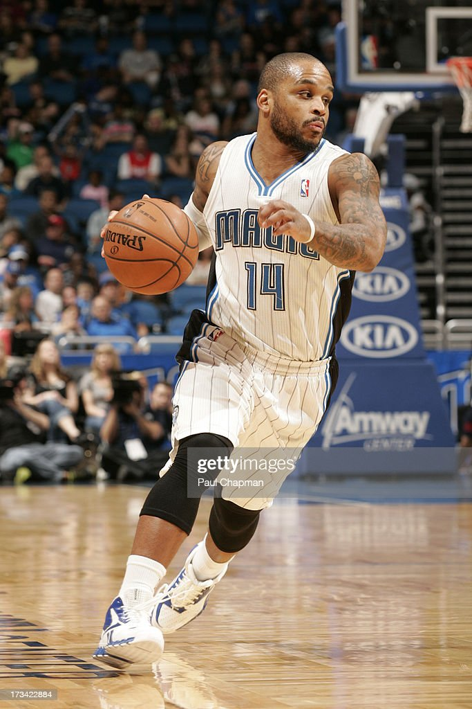 Jameer Nelson #14 of the Orlando Magic brings the ball up court during the game between the Philadelphia 76ers and the Orlando Magic on March 10, 2013 at Amway Center in Orlando, Florida.