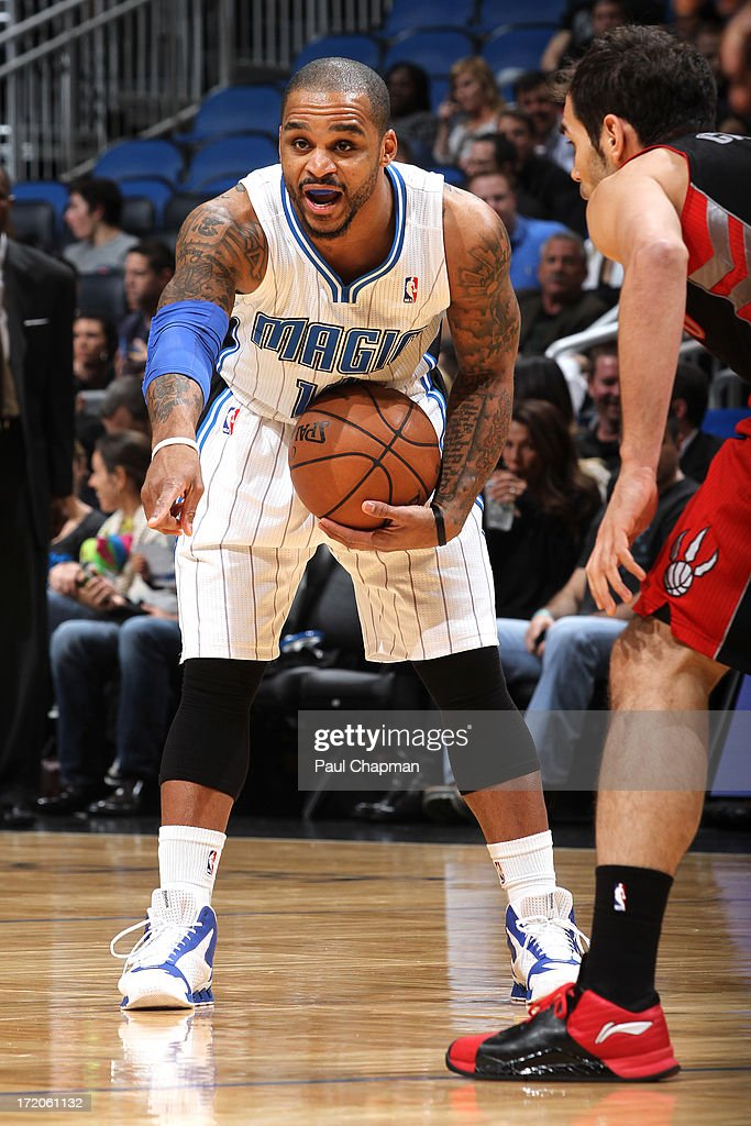 <a gi-track='captionPersonalityLinkClicked' href=/galleries/search?phrase=Jameer+Nelson&family=editorial&specificpeople=202057 ng-click='$event.stopPropagation()'>Jameer Nelson</a> #14 of the Orlando magic calls for a screen during a game against the Toronto Raptors on January 24, 2013 at Amway Center in Orlando, Florida.