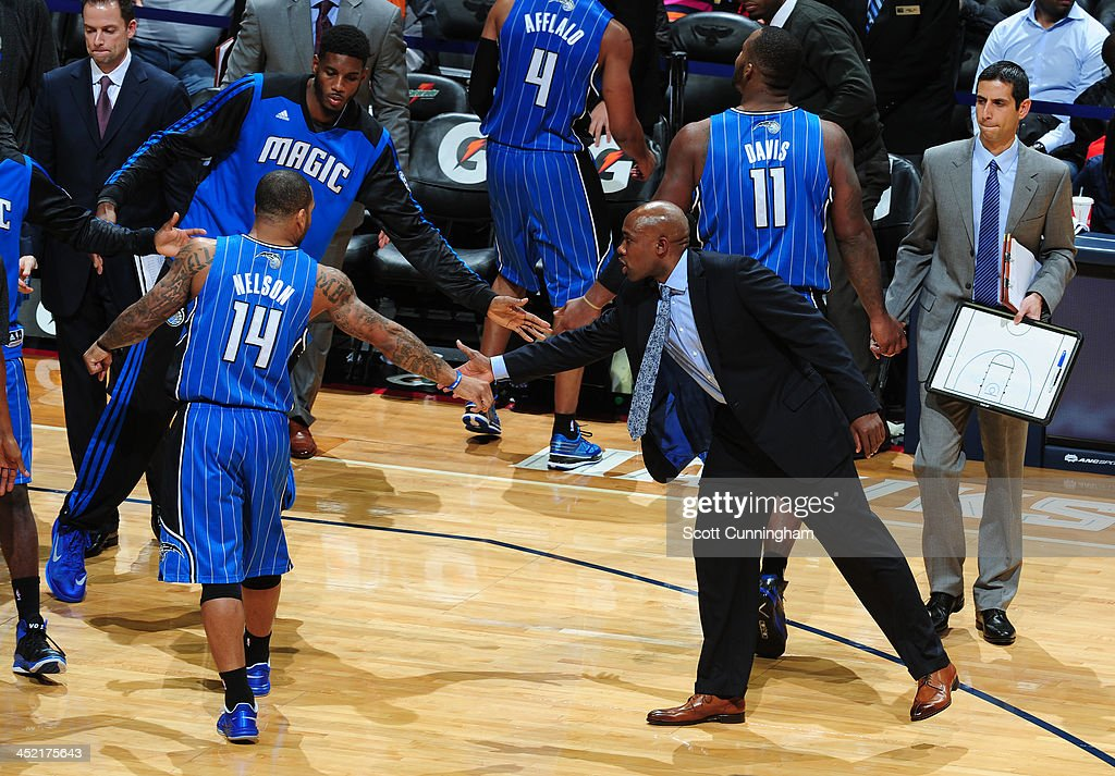 <a gi-track='captionPersonalityLinkClicked' href=/galleries/search?phrase=Jameer+Nelson&family=editorial&specificpeople=202057 ng-click='$event.stopPropagation()'>Jameer Nelson</a> #14 of the Orlando Magic celebrates with <a gi-track='captionPersonalityLinkClicked' href=/galleries/search?phrase=Jacque+Vaughn&family=editorial&specificpeople=201747 ng-click='$event.stopPropagation()'>Jacque Vaughn</a> during the game against the Atlanta Hawks on November 26, 2013 at Philips Arena in Atlanta, Georgia.