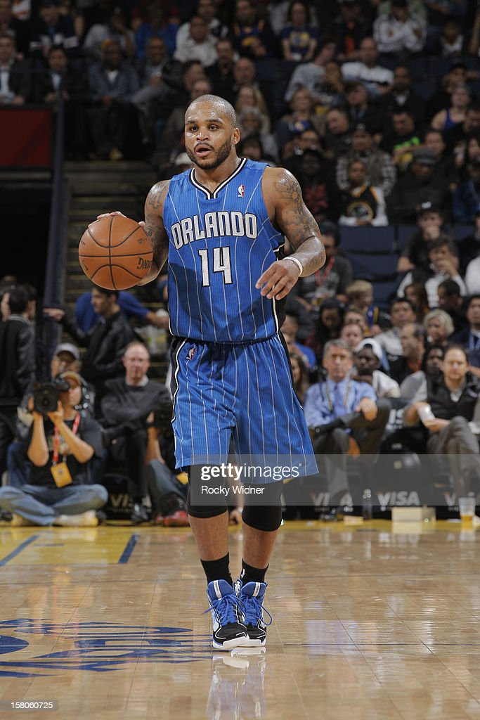 <a gi-track='captionPersonalityLinkClicked' href=/galleries/search?phrase=Jameer+Nelson&family=editorial&specificpeople=202057 ng-click='$event.stopPropagation()'>Jameer Nelson</a> #14 of the Orlando Magic dribbles against the Golden State Warriors on December 3, 2012 at Oracle Arena in Oakland, California.