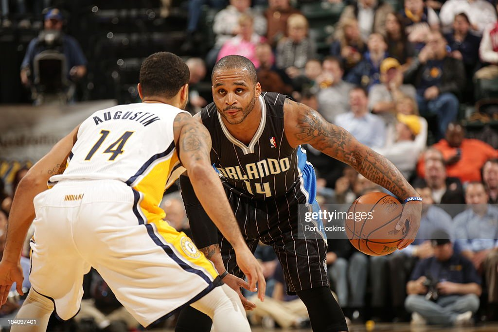 Jameer Nelson #14 of the Orlando Magic dribbles the ball against D.J. Augustin #14 of the Indiana Pacers Orlando Magic on March 19, 2013 at Bankers Life Fieldhouse in Indianapolis, Indiana.