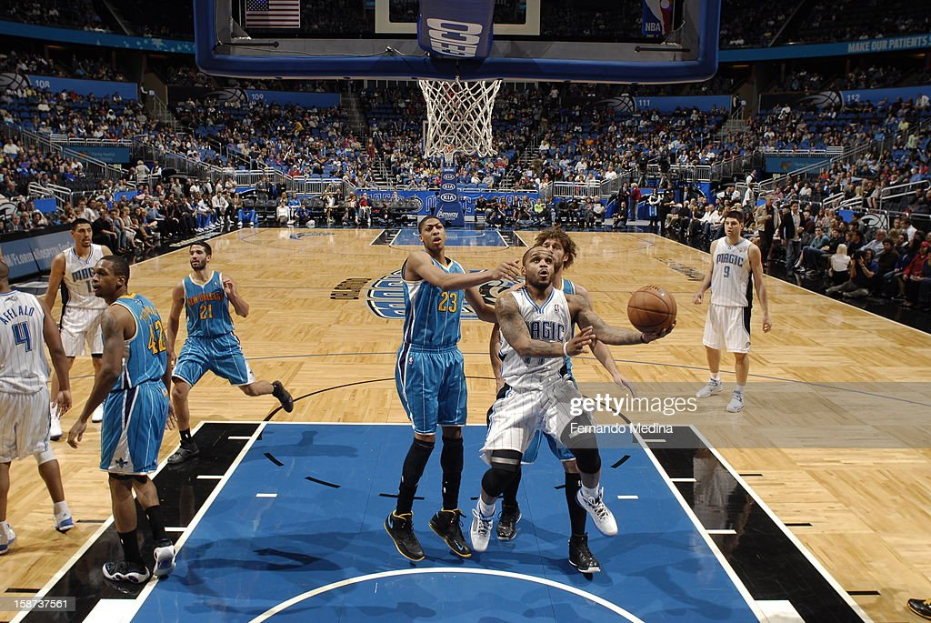<a gi-track='captionPersonalityLinkClicked' href=/galleries/search?phrase=Jameer+Nelson&family=editorial&specificpeople=202057 ng-click='$event.stopPropagation()'>Jameer Nelson</a> #14 of the Orlando Magic dribbles through traffic for the easy layup against the New Orleans Hornets during the game on December 26, 2012 at Amway Center in Orlando, Florida.