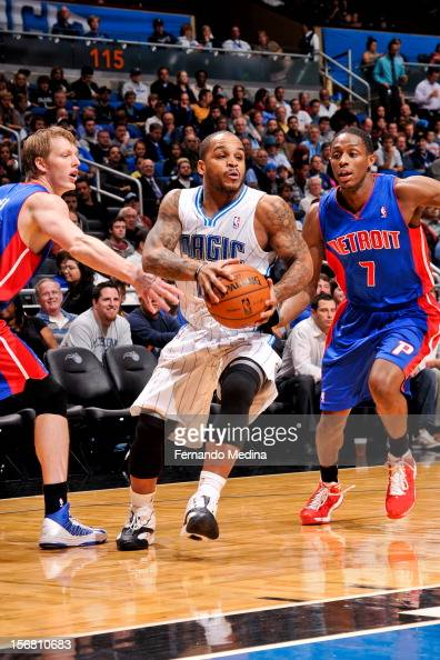 Jameer Nelson of the Orlando Magic drives against Brandon Knight and Kyle Singler of the Detroit Pistons on November 21 2012 at Amway Center in...