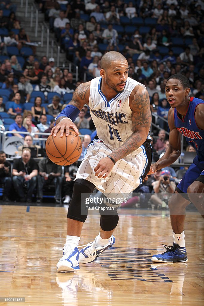 Jameer Nelson #14 of the Orlando Magic drives against Brandon Knight #7 of the Detroit Pistons during the game between the Detroit Pistons and the Orlando Magic on January 27, 2013 at Amway Center in Orlando, Florida.