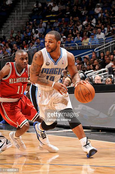 Jameer Nelson of the Orlando Magic drives against Earl Boykins of the Milwaukee Bucks on April 5 2011 at the Amway Center in Orlando Florida NOTE TO...