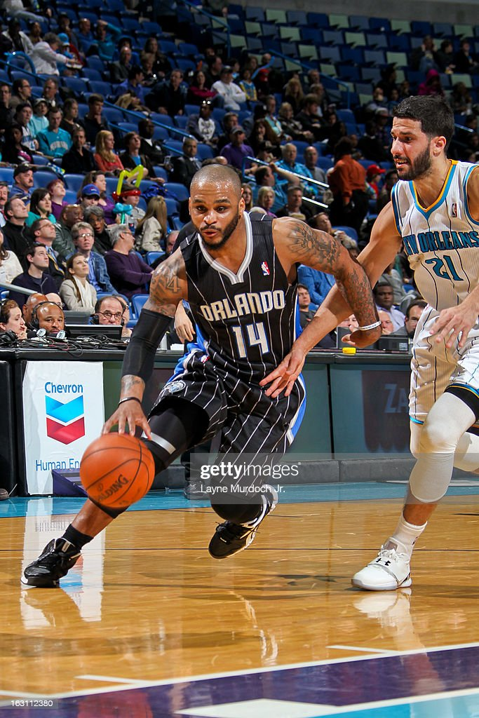 Jameer Nelson #14 of the Orlando Magic drives against Greivis Vasquez #21 of the New Orleans Hornets on March 4, 2013 at the New Orleans Arena in New Orleans, Louisiana.
