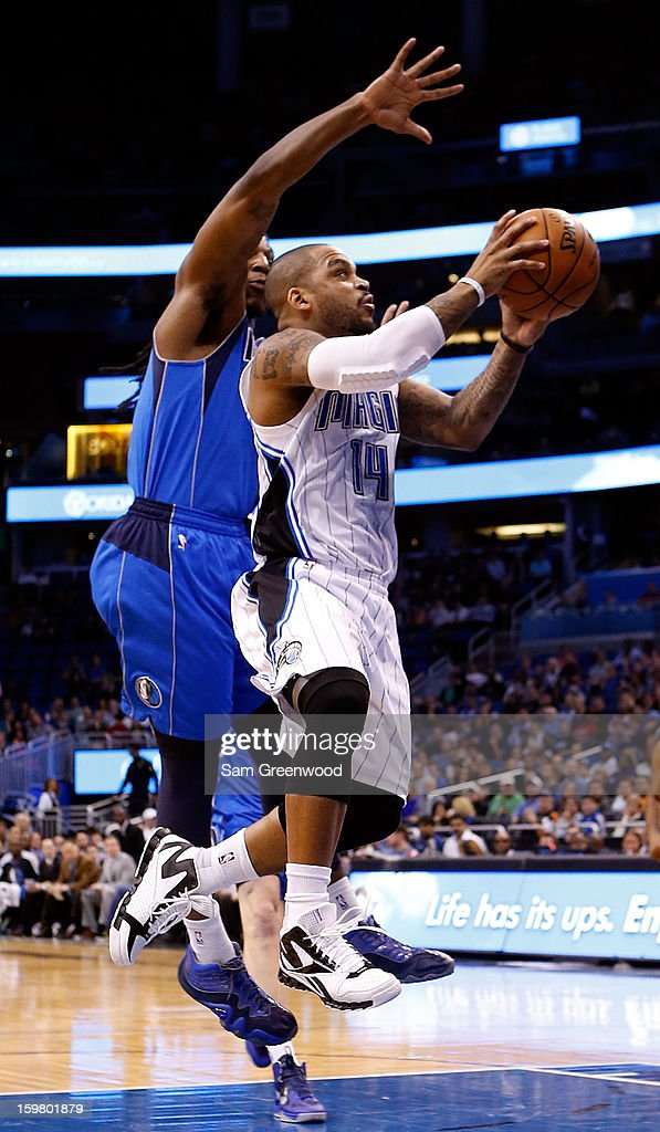 Jameer Nelson #14 of the Orlando Magic drives against Jae Crowder #9 of the Dallas Mavericks during the game at Amway Center on January 20, 2013 in Orlando, Florida.