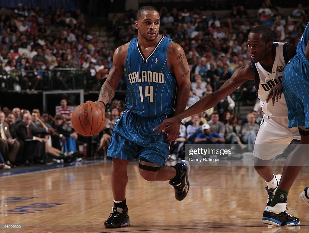 Jameer Nelson #14 of the Orlando Magic drives against Rodrigue Beaubois #3 of the Dallas Mavericks during a game at the American Airlines Center on April 1, 2010 in Dallas, Texas.