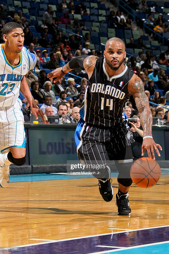 <a gi-track='captionPersonalityLinkClicked' href=/galleries/search?phrase=Jameer+Nelson&family=editorial&specificpeople=202057 ng-click='$event.stopPropagation()'>Jameer Nelson</a> #14 of the Orlando Magic drives ahead of Anthony Davis #23 of the New Orleans Hornets on March 4, 2013 at the New Orleans Arena in New Orleans, Louisiana.