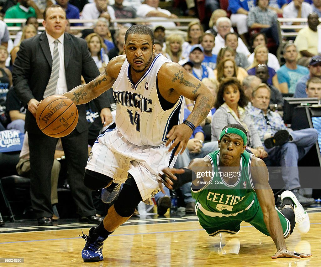 Jameer Nelson #14 of the Orlando Magic drives past Rajon Rondo #9 of the Boston Celtics in Game One of the Eastern Conference Finals during the 2010 NBA Playoffs at Amway Arena on May 16, 2010 in Orlando, Florida.