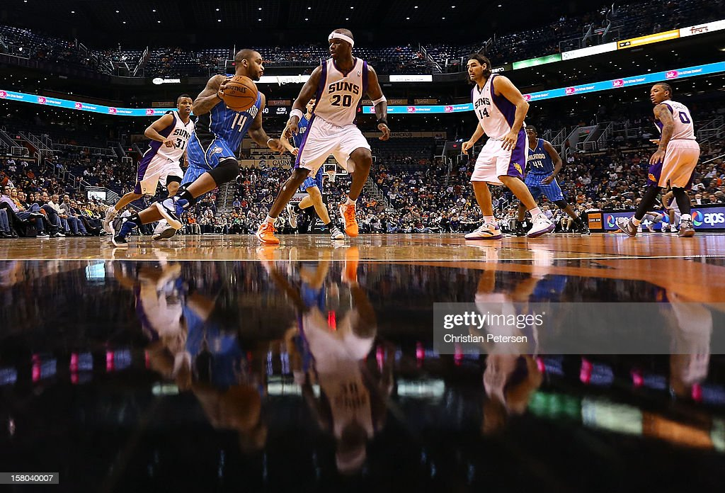 Jameer Nelson #14 of the Orlando Magic drives the ball against Jermaine O'Neal #20 of the Phoenix Suns during the NBA game at US Airways Center on December 9, 2012 in Phoenix, Arizona.