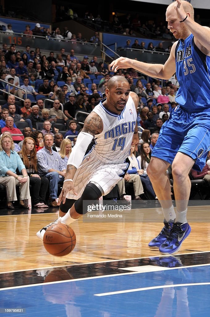 Jameer Nelson #14 of the Orlando Magic drives to the basket against Chris Kaman #35 of the Dallas Mavericks on January 20, 2013 at Amway Center in Orlando, Florida.