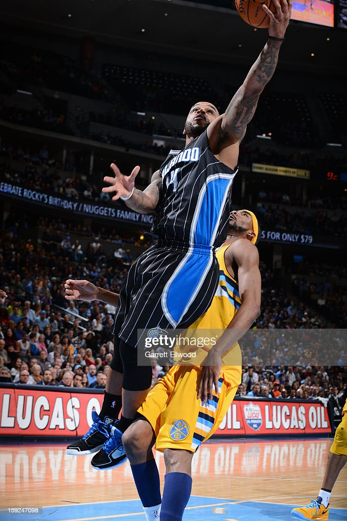 <a gi-track='captionPersonalityLinkClicked' href=/galleries/search?phrase=Jameer+Nelson&family=editorial&specificpeople=202057 ng-click='$event.stopPropagation()'>Jameer Nelson</a> #14 of the Orlando Magic drives to the basket against <a gi-track='captionPersonalityLinkClicked' href=/galleries/search?phrase=Corey+Brewer&family=editorial&specificpeople=234749 ng-click='$event.stopPropagation()'>Corey Brewer</a> #13 of the Denver Nuggets on January 9, 2013 at the Pepsi Center in Denver, Colorado.