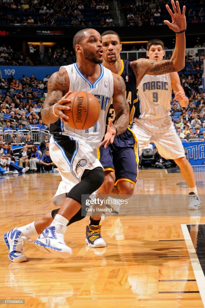 <a gi-track='captionPersonalityLinkClicked' href=/galleries/search?phrase=Jameer+Nelson&family=editorial&specificpeople=202057 ng-click='$event.stopPropagation()'>Jameer Nelson</a> #14 of the Orlando Magic drives to the basket against George Hill #3 of the Indiana Pacers during a game on January 16, 2013 at Amway Center in Orlando, Florida.