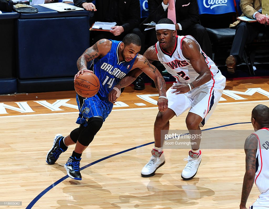 <a gi-track='captionPersonalityLinkClicked' href=/galleries/search?phrase=Jameer+Nelson&family=editorial&specificpeople=202057 ng-click='$event.stopPropagation()'>Jameer Nelson</a> #14 of the Orlando Magic drives to the basket against <a gi-track='captionPersonalityLinkClicked' href=/galleries/search?phrase=Joe+Johnson+-+Basketball+Player&family=editorial&specificpeople=201652 ng-click='$event.stopPropagation()'>Joe Johnson</a> #2 of the Atlanta Hawks in Game Three of the Eastern Conference Quarterfinals in the 2011 NBA Playoffs on April 22, 2011 at Philips Arena in Atlanta, Georgia.