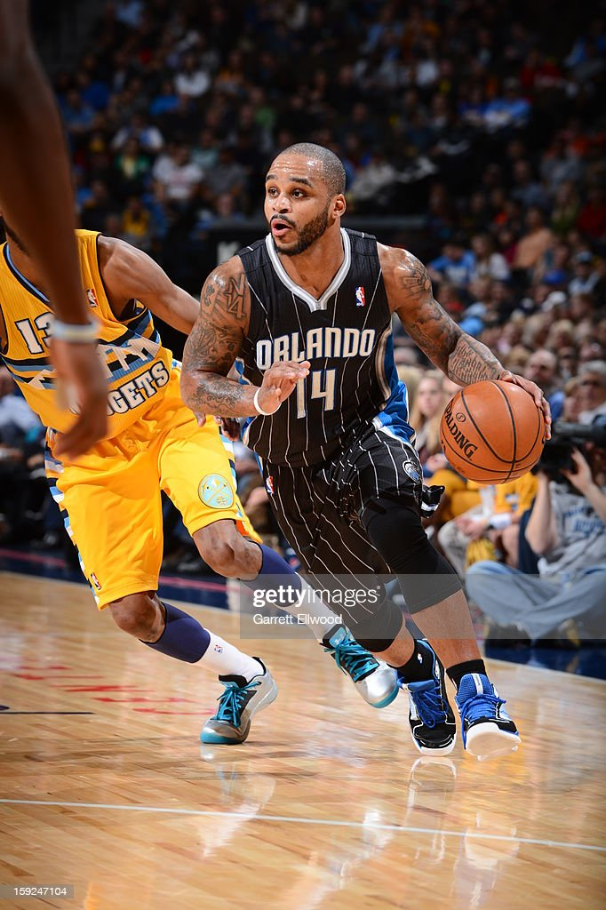 <a gi-track='captionPersonalityLinkClicked' href=/galleries/search?phrase=Jameer+Nelson&family=editorial&specificpeople=202057 ng-click='$event.stopPropagation()'>Jameer Nelson</a> #14 of the Orlando Magic drives to the basket against the Denver Nuggets on January 9, 2013 at the Pepsi Center in Denver, Colorado.