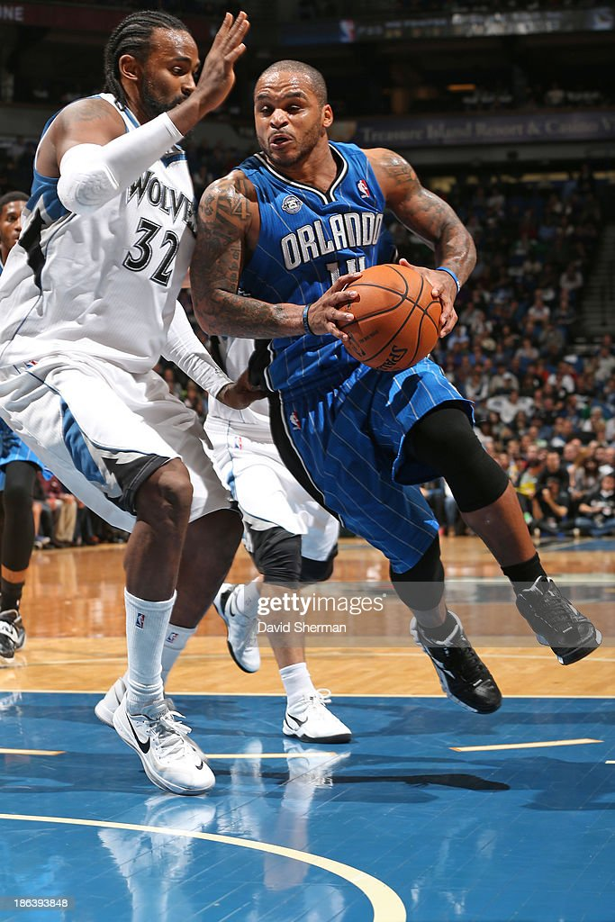 Jameer Nelson #14 of the Orlando Magic drives to the basket against the Minnesota Timberwolves during the season and home opening game on October 30, 2013 at Target Center in Minneapolis, Minnesota.
