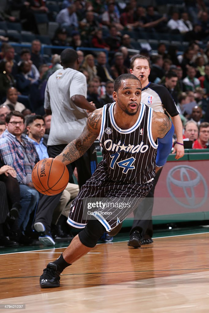 <a gi-track='captionPersonalityLinkClicked' href=/galleries/search?phrase=Jameer+Nelson&family=editorial&specificpeople=202057 ng-click='$event.stopPropagation()'>Jameer Nelson</a> #14 of the Orlando Magic drives to the basket against the Milwaukee Bucks on March 10, 2014 at the BMO Harris Bradley Center in Milwaukee, Wisconsin.