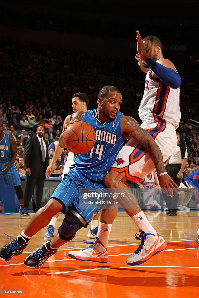 <a gi-track='captionPersonalityLinkClicked' href=/galleries/search?phrase=Jameer+Nelson&family=editorial&specificpeople=202057 ng-click='$event.stopPropagation()'>Jameer Nelson</a> #14 of the Orlando Magic drives to the basket around <a gi-track='captionPersonalityLinkClicked' href=/galleries/search?phrase=Tyson+Chandler&family=editorial&specificpeople=202061 ng-click='$event.stopPropagation()'>Tyson Chandler</a> #6 of the New York Knicks during the game on March 28, 2012 at Madison Square Garden in New York City.